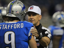 Referee Clete Blakeman (34) meets with Detroit Lions quarterback Matthew Stafford before the first quarter of an NFL football game against the Minnesota Vikings at Ford Field in Detroit, Sunday, Sept. 30, 2012. (AP Photo/Carlos Osorio)
