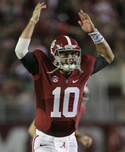 Alabama quarterback AJ McCarron (10) reacts after throwing a touchdown in the first half of an NCAA college football game against Mississippi at Bryant-Denny Stadium in Tuscaloosa, Ala., Saturday, Sept. 29, 2012. (AP Photo/Dave Martin)