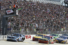 Pole-sitter Denny Hamlin (11) and other drivers get the green flag to start the NASCAR Sprint Cup Series auto race Sunday, Sept. 30, 2012, at Dover International Speedway in Dover, Del. (AP Photo/The News-Journal, Daniel Sato) NO SALES