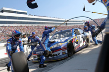 Kasey Kahne makes a pit stop during the NASCAR Sprint Cup Series auto race Sunday, Sept. 30, 2012, at Dover International Speedway in Dover, Del. (AP Photo/The News-Journal, Daneil Sato) NO SALES