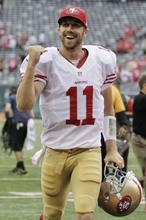 San Francisco 49ers quarterback Alex Smith (11) reacts after an NFL football game against the New York Jets Sunday, Sept. 30, 2012, in East Rutherford, N.J. the 49ers won the game 34-0. (AP Photo/Kathy Willens)