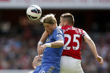 Arsenal's Carl Jenkinson, right, competes for the ball with Chelsea's Fernando Torres during the English Premier League soccer match at the Emirates Stadium in London, Saturday, Sept. 29, 2012. (AP Photo/Matt Dunham)