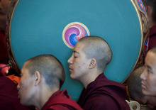 Exiled Tibetan Buddhist nuns listen during a teaching by Tibetan spiritual leader the Dalai Lama, not seen, at the Tsuglakhang Temple in Dharmsala, India, Monday, Oct. 1, 2012. (AP Photo/Ashwini Bhatia)