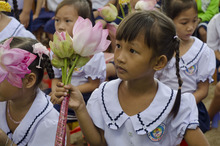 Courtesy photo A girl holds flowers during Room to Read's 10 millionth book ceremony in Vietnam.