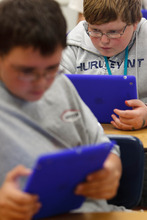 Trent Nelson  |  The Salt Lake Tribune Jacen Hansen and Adam Boot read books on iPads during a reading class at Dixon Middle School in Provo, Utah, Tuesday September 25, 2012.