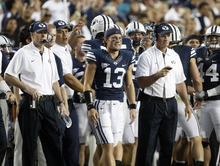 Chris Detrick  |  The Salt Lake Tribune BYU head coach Bronco Mendenhall and quarterback Riley Nelson watch during the game against Hawaii at LaVell Edwards Stadium in Provo on Friday, Sept. 28, 2012.