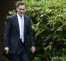 Republican presidential candidate and former Massachusetts Gov. Mitt Romney leaves the Church of Jesus Christ of Latter-day Saints, in Belmont, Mass., Sunday, Sept. 30, 2012. (AP Photo/Charles Dharapak)