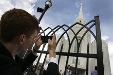 Scott Sommerdorf  |  The Salt Lake Tribune              Edward Pingel of Tremonton makes a photograph the new temple in Brigham City after it was dedicated, at 250 S. Main St., Sunday, Sept. 23, 2012.
