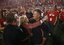 Scott Sommerdorf  |  The Salt Lake Tribune              Utah head coach Kyle Whittingham gets congratulated by his wife Jamie after Utah defeated BYU 24-21, Saturday, September 15, 2012.