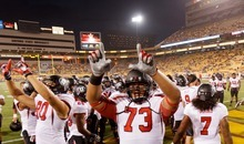 Trent Nelson  |  The Salt Lake Tribune Utah offensive linesman Jeremiah Poutasi (73) and teammates call out to Utah fans as the University of Utah prepares to face Arizona State, college football in Tempe, Arizona, Saturday, September 22, 2012.