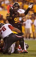 Trent Nelson  |  The Salt Lake Tribune Arizona State's Will Sutton (90) celebrates after bringing down Utah running back John White (15) or Utah defensive back Michael Walker (15) as the University of Utah faces Arizona State, college football in Tempe, Arizona, Saturday, September 22, 2012.