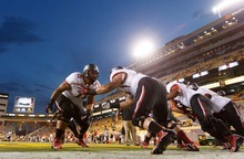 Trent Nelson  |  The Salt Lake Tribune Doing their part to keep up the trend of college football teams wearing bold, unusual, imaginative uniform combinations, the Utes uncloaked white-on-black helmets worn with white jerseys and black pants during the game against Arizona State on Sept. 22, 2012.