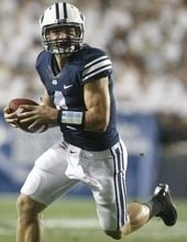 Chris Detrick  |  The Salt Lake Tribune Brigham Young Cougars quarterback Taysom Hill (4) runs the ball during the first half of the game against Washington State at LaVell Edwards Stadium Thursday August 30, 2012. BYU is winning the game 24-6.