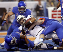 Brigham Young running back Michaeel Alisa is stopped near the goal line by the Boise State defense during the first half of an NCAA college football game Thursday, Sept. 20, 2012, at Bronco Stadium in Boise, Idaho. (AP Photo/The Idaho Statesman, Darin Oswald)