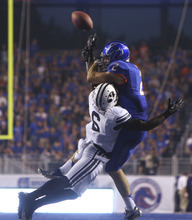 Brigham Young's Jordan Johnson breaks up a fourth-down pass intended for receiver Boise State's Matt Miller during an NCAA college football game Thursday, Sept. 20, 2012, in Boise, Idaho. (AP Photo/The Idaho Statesman, Joe Jaszewski)