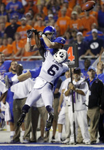 Boise State wide receiver Matt Miller misses a high pass on fourth down while covered by Brigham Young defensive back Jordan Johnson during an NCAA college football game Thursday, Sept. 20, 2012, in Boise, Idaho. (AP Photo/The Idaho Statesman, Darin Oswald)