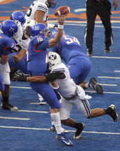 Boise State quarterback Joe Southwick gets his pass off just before a hit by Brigham Young defensive back Preston Hadley during an NCAA college football game Thursday, Sept. 20, 2012, in Boise, Idaho. (AP Photo/The Idaho Statesman, Darin Oswald)