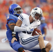 Boise State defensive end Demarcus Lawrence sacks Brigham Young's Riley Nelson during an NCAA college football game Thursday, Sept. 20, 2012, in Boise, Idaho. (AP Photo/The Idaho Statesman, Joe Jaszewski)