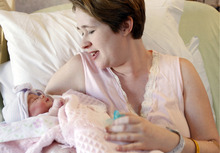 HOLD FOR RELEASE ON WEDNESDAY, OCT. 3, 2012 AT 12:01 A.M. - FILE - In this Friday, Nov. 11, 2011 file photo, LeeAnn Taylor-Dragon holds her newborn baby, Katelyn, at Christus Spohn Hospital South in Corpus Christi, Texas. U.S. births fell for the fourth year in a row, the government reported Wednesday, Oct. 3, 2012 with experts calling it more proof that the weak economy has continued to dampen enthusiasm for having children. But there may be a silver lining: The decline in 2011 was just 1 percent - not as sharp a fall-off as the 2 to 3 percent drop seen in other recent years. (AP Photo/Corpus Christi Caller-Times, Michael Zamora)