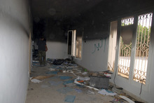 FILE - This Sept. 12, 2012 file photo shows a man walking through a room in the gutted U.S. consulate in Benghazi, Libya, after an attack that killed four Americans, including Ambassador Chris Stevens. Leaders of a House committee said Tuesday that U.S. diplomats in Libya made repeated requests for increased security for the consulate in Benghazi and were turned down by officials in Washington. In a letter to Secretary of State Hillary Rodham Clinton, Chairman Darrell Issa and Rep. Jason Chaffetz said their information came from
