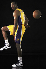 Los Angeles Lakers enter Dwight Howard poses for portraits during their NBA basketball media day at the team's headquarters in El Segundo, Calif., Monday, Oct. 1, 2012. (AP Photo/Reed Saxon)