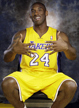 Los Angeles Lakers' Kobe Bryant gestures during their NBA basketball media day at the team's headquarters in El Segundo, Calif., Monday, Oct. 1, 2012. (AP Photo/Reed Saxon)