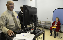 Joseph Strickland prepares voter identification for former mayor of Pittsburgh, Sophie Masloff, 94, of Squirrel Hill, Monday, Oct.1, 2012 evening at the CCAC Homewood-Brushton Center. One of the toughest of a new wave of U.S. state laws in a debate over voting rights was put on hold Tuesday as a judge postponed Pennsylvania's controversial voter identification requirement just weeks before the presidential election. The law requires each voter to show a valid photo ID. (AP Photo/Pittsburgh Post-Gazette, Julia Rendleman).
