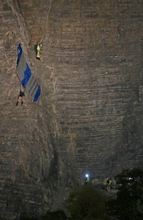 A BASE jumper is rescued after his parachute got caught on a cliff in Provo Canyon late Oct. 1, 2012. Photo by George Frey.
