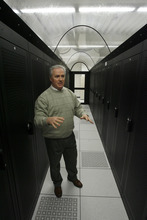 Lindon - Dave Jenkins, VP of Marketing and Business Development for C7 formerly known as Center 7 Inc., shows off a cold row, a climate controlled corridor of servers in the new Data Center on Thursday, Jan. 8, 2008, which provides a secure site for other companies computer systems and also provides backup services and other online services to companies.  Photo by Francisco Kjolseth/The Salt Lake Tribune 01/08/2009