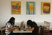 Leah Hogsten  |  The Salt Lake Tribune Brunella Saroli eats lunch with her brother Marcelo Saroli at Melty Way, a fast-casual restaurant that is putting a grown-up spin on grilled cheese sandwiches.