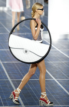 A model wears a creation by German fashion designer Karl Lagerfeld for Chanel's ready to wear Spring-Summer 2013 collection, presented in Paris,Tuesday, Oct.2, 2012. (AP Photo/Jacques Brinon)