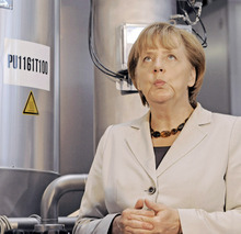 German Chancellor Angela Merkel reacts during a company tour after the opening of the Fraunhofer Center for Chemical-Biotechnological Processes, CBP, in Leuna, central Germany, Tuesday, Oct. 2, 2012. The Fraunhofer CBP will focus on sustainable processes along the entire value creation chain, developing products on the basis of sustainable resources. (AP Photo/Jens Meyer)