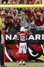 Arizona Cardinals wide receiver Andre Roberts (12) celebrates his touchdown against the Miami Dolphins during the second half of an NFL football game, Sunday, Sept. 30, 2012, in Glendale, Ariz. The Cardinals won 24-21 in overtime. (AP Photo/Ross D. Franklin)