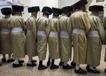 Ultra Orthodox Jews dance as they celebrate the holiday of Sukkot at a yeshiva in the Ultra Orthodox Jewish neighborhood of Mea Shearim in Jerusalem, Monday, Oct. 1, 2012. (AP Photo/Sebastian Scheiner)