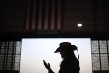 Campaign volunteer Calandra Vargas waits for an event to being with Republican presidential candidate and former Massachusetts Gov. Mitt Romney at the Wings Over the Rockies Air and Space Museum, Monday, Oct. 1, 2012, in Denver. (AP Photo/David Goldman)