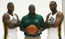 Steve Griffin | The Salt Lake Tribune   Jazz big men Paul Millsap and Al Jefferson pose for photographs with head coach Tyrone Corbin during Jazz media day in Salt Lake City on Oct. 1, 2012.