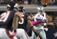 Dallas Cowboys quarterback Tony Romo (9) is sacked forcing the turnover during the second half of an NFL football game against the Chicago Bears, Monday, Oct. 1, 2012 in Arlington, Texas. (AP Photo/LM Otero)