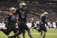 Washington's Desmond Trufant celebrates his interception against Stanford play late in the second half of an NCAA college football game against Stanford, Thursday, Sept. 27, 2012, in Seattle. Washington beat Stanford, 17-13. (AP Photo/Ted S. Warren)