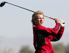 Al Hartmann     The Salt Lake Tribune First day leader Austin Banz of West High School watches his drive on the final round of the 5A  Boys Golf High School State Championship at River Bend Golf Course in  Riverton.