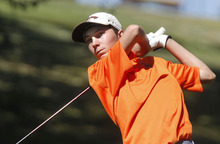 Al Hartmann     The Salt Lake Tribune Brighton High School's Andrews Reilly makes a drive on the final round of the 5A Boys Golf High School State Championship at River Bend Golf Course in  Riverton.