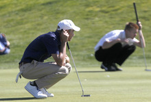 Al Hartmann     The Salt Lake Tribune Syracuse High School's Cameron Spever, left and Lone Peak High School's Cameron Webb line up their putts during the final round of the 5A Boys Golf High School State Championship at River Bend Golf Course in  Riverton.