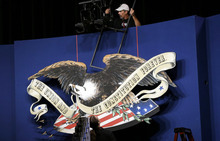 A worker helps with the set for the presidential debate at the Magness Arena at the Daniel L. Ritchie Center for Sports and Wellness on the campus of the University of Denver, Monday, Oct. 1, 2012, in Denver. (AP Photo/Eric Gay)