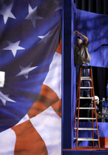 LeRoy Gilbert works on the set for the presidential debate at the Magness Arena at the Daniel L. Ritchie Center for Sports and Wellness on the campus of the University of Denver, Monday, Oct. 1, 2012, in Denver. (AP Photo/Eric Gay)