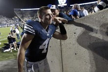 Chris Detrick  |  The Salt Lake Tribune Brigham Young Cougars quarterback Taysom Hill (4) greets fans after the game at LaVell Edwards Stadium Friday September 28, 2012. BYU won the game 47-0.