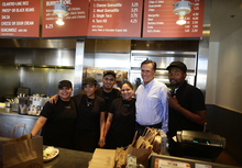 Republican presidential candidate and former Massachusetts Gov. Mitt Romney makes an unscheduled stop at a Chipotle restaurant in Denver, Tuesday, Oct. 2, 2012. (AP Photo/Charles Dharapak)