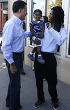 Republican presidential candidate and former Massachusetts Gov. Mitt Romney greets a man and a young girl as he makes an unscheduled stop at a Chipotle restaurant in Denver, Tuesday, Oct. 2, 2012. (AP Photo/Charles Dharapak)