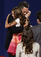 Republican presidential candidate and former Massachusetts Gov. Mitt Romney embraces granddaughter Chloe at the end of the first presidential debate with President Barack Obama in Denver, Wednesday, Oct. 3, 2012. (AP Photo/Charles Dharapak)