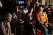 Members of the Massachusetts GOP Young Republicans react in Boston, Wednesday, Oct. 3, 2012, as they watch the first presidential debate between President Barack Obama and Republican Mitt Romney. (AP Photo/Elise Amendola)