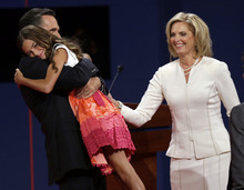 Republican presidential nominee Mitt Romney  hugs his granddaughter as his wife Ann looks on during the first presidential debate at the University of Denver, Wednesday, Oct. 3, 2012, in Denver. (AP Photo/Charlie Neibergall)