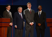 Jim Lehrer, executive editor of PBS' NewsHour and debate moderator, takes a photograph with the debate stand-ins at the first 2012 Presidential Debate at the University of Denver in Denver, Colorado on October 3, 2012. Craig F. Walker, The Denver Post